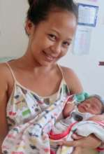 Joyful new mother and baby in birth center