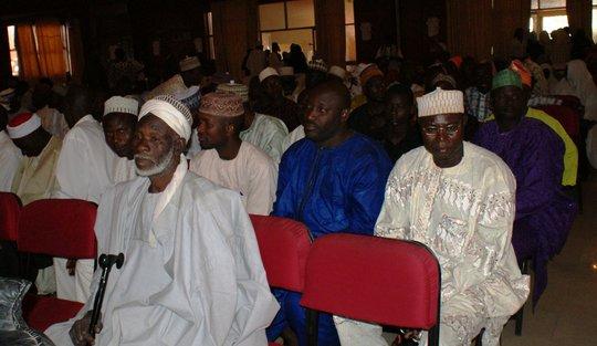 Men participate in community meeting