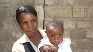 "Catherine, health educator, with ""miso"" baby"
