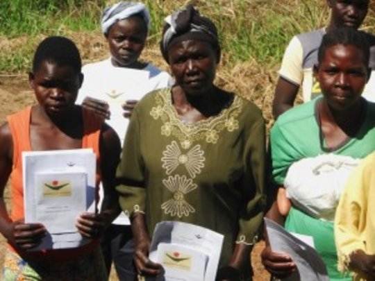 WfWI participants show off their program materials