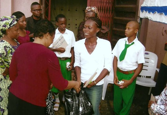 president presenting food to an orphan