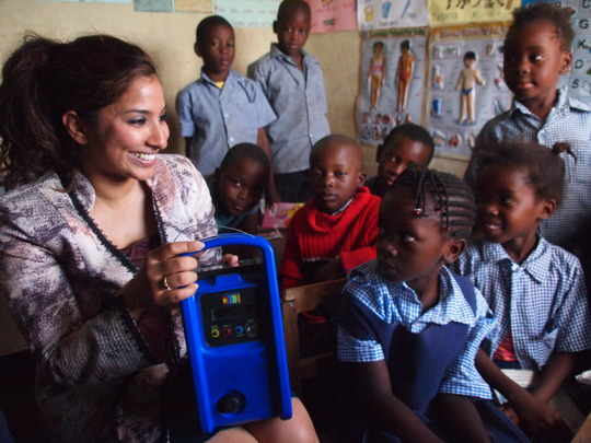 Uzma with children at Moon City Community School