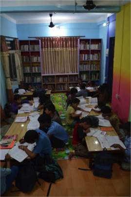 Pupils reading in one of the mini libraries