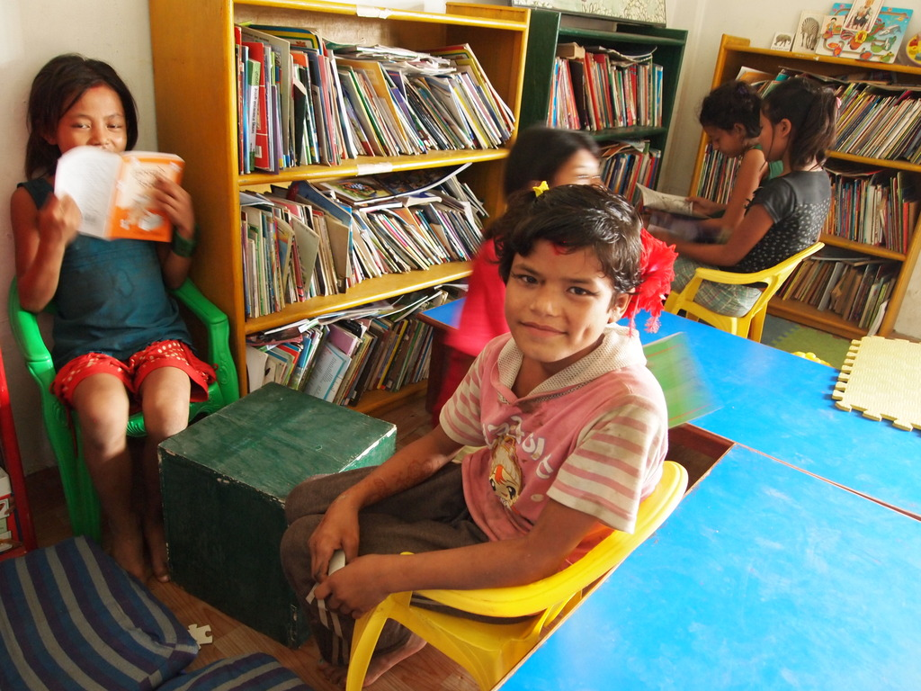 Children reading at the community library