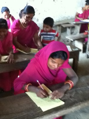 Examination time at a women's literacy class