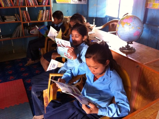 Reading time for students at the mini-library!
