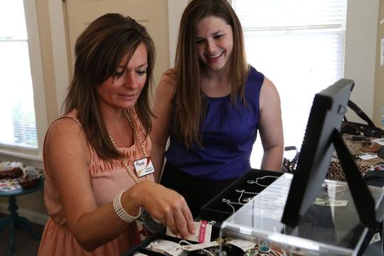 Shay Kaldem assists customer in Edie's Village.