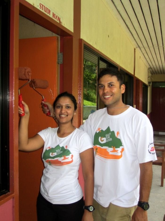 Challengers painting at the charity home in Borneo