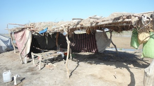 Damaged house at village Agha Akhtar Jaan Patha