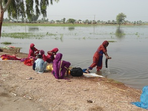 Women have to use flood water for their daily use