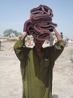 Mr. Jumo Khan taking Floor matts to home