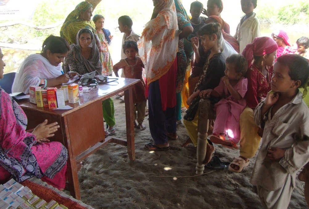 Women getting treatment in mobile clinic