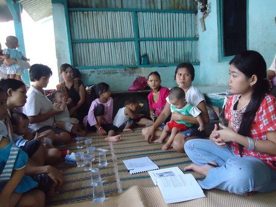 Participants Learn from Volunteer Coordinator