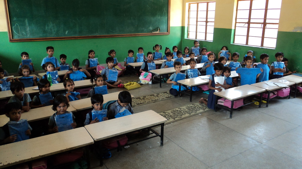 School Kids with their new school T-shirts.