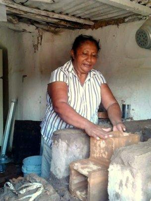 Woman at eco-friendly stove in El Nance, Honduras
