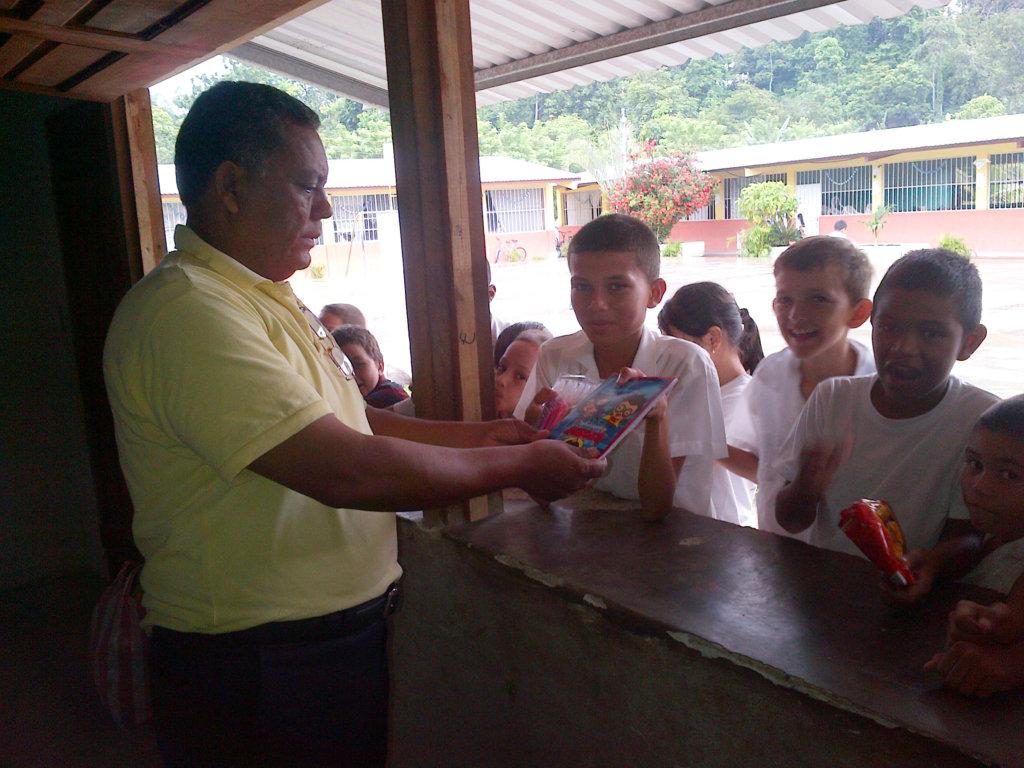 Students receiving the school supplies!