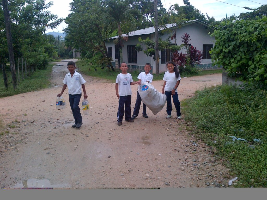 Students collecting recyclables around a town
