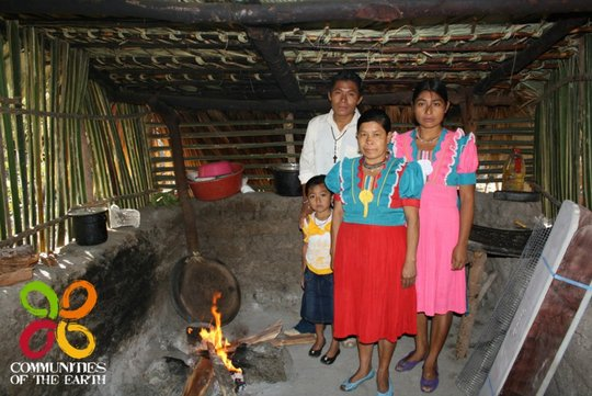 Victor and family in their open fire kitchen