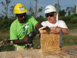 Arthur works alongside a volunteer from Alostar