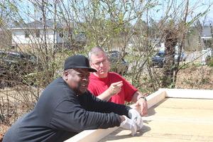Mr. Cooper worked alongside volunteers on his home