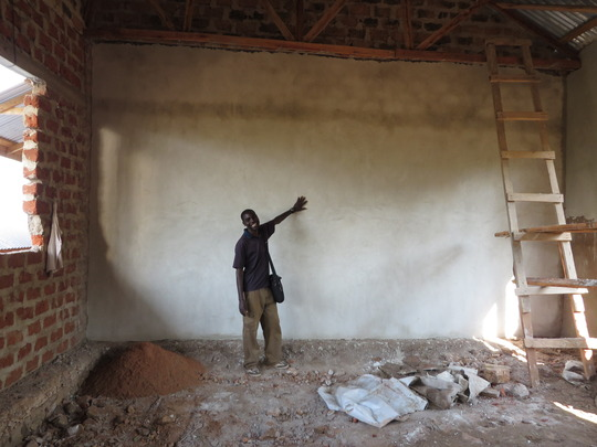 Lucas happy to see plaster going up!