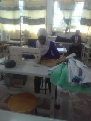 Rabia in action as a tailor