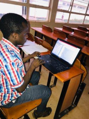 Saidi working on his thesis