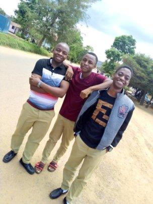 Sospeter (left) and Anzaruni (center) at College