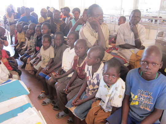 Children and parents waiting for treatment