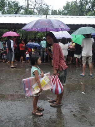 Mother and child with their relief package