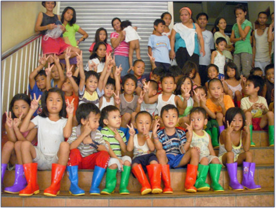 Children with their new rain boots