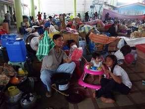 Families receiving their hygiene kits