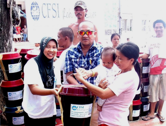 Distributing kits to local families