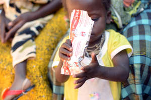 A child eating Plumpy'Nut in Burkina Faso
