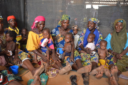 Mothers and children in Niger receive Plumpy'Nut