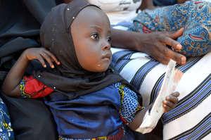 Little girl in Burkina Faso receives Plumpy'Nut