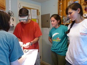 Interns observe Exam in Small Room
