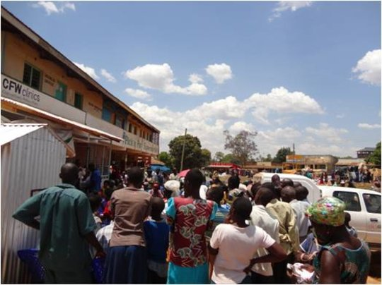 CFW--crowd watching public health drama--Ugunja