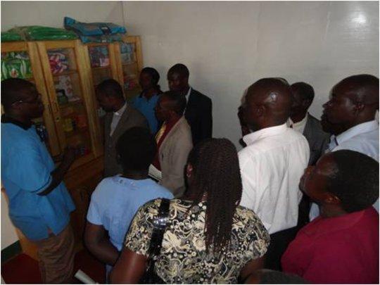 CFW--nurse explaining hygiene & prevention--Ugunja