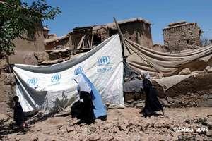 Afghan returnees walk...
