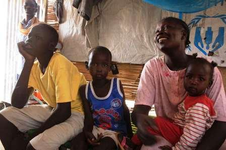 Helen Akompeo (right) and fellow Sudanese refugees