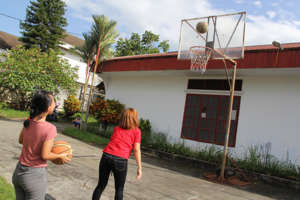 Residents Playing 'Knock-Out' Basketball