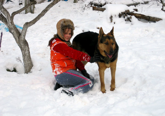 Alina with their dog Moukhtar