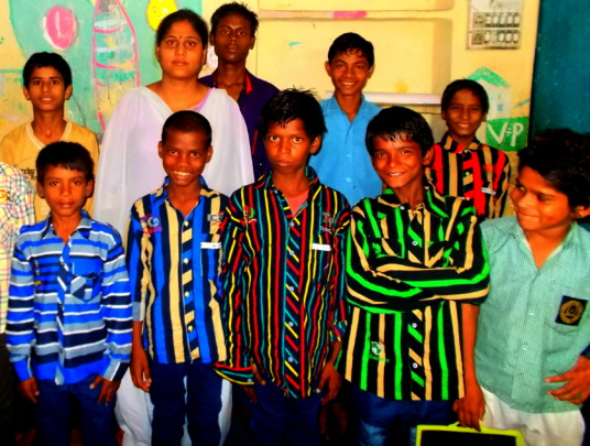 Riya with other children at the centre