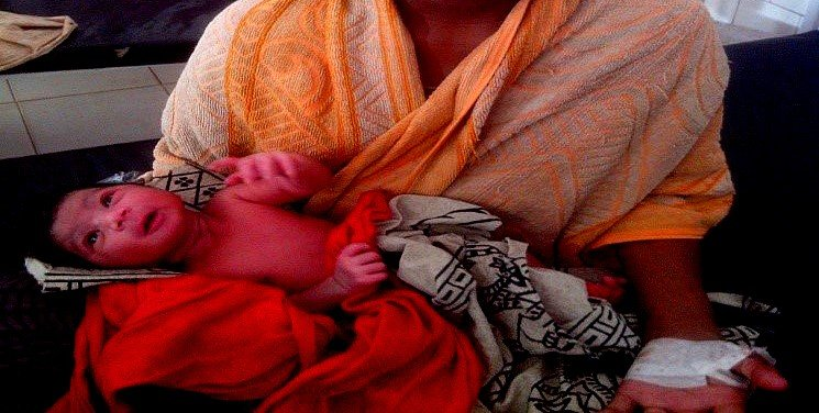 Kushi in her mother arms
