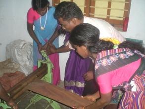 Photo - women building rat catching devices