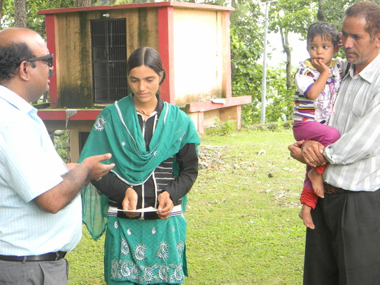 Jitendra Dhyani's widow receiving relief cheque