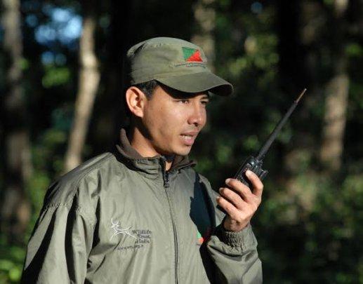 Forest guard wearing rain suit