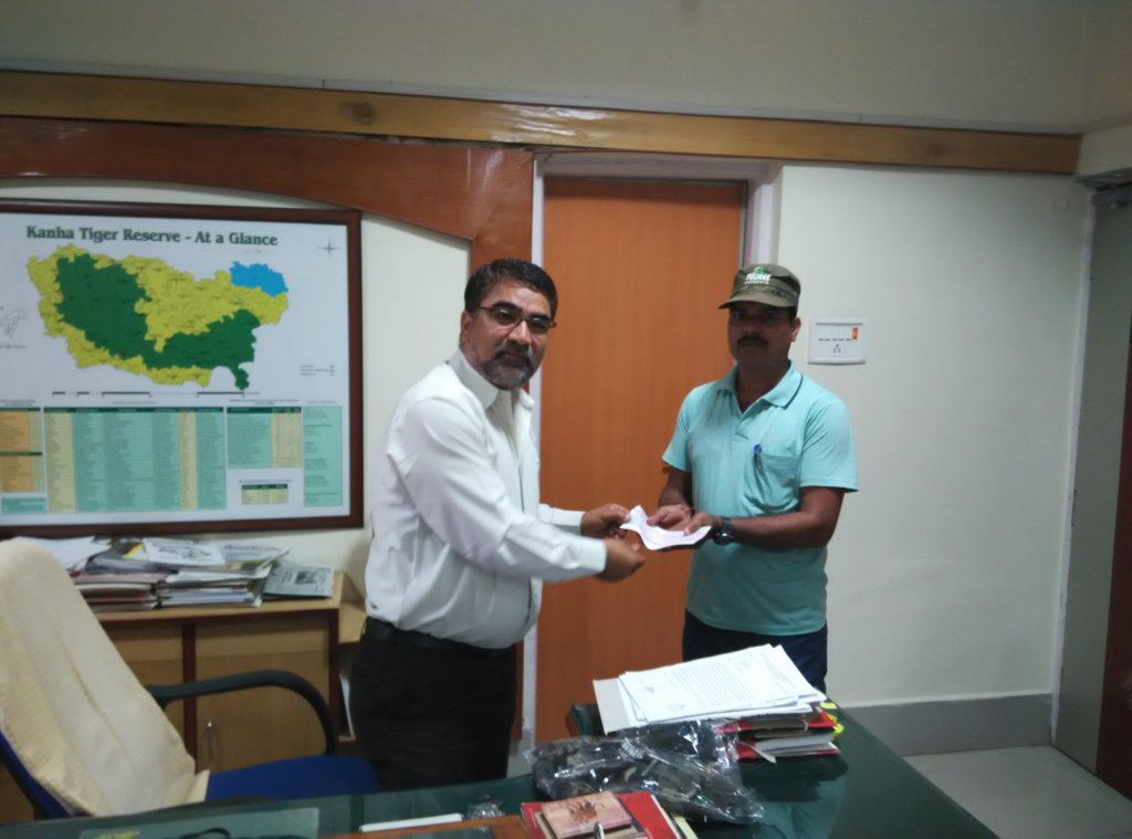Ex gratia check being handed over