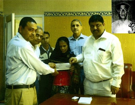 Rabia Khatun receiving check for insurance amount